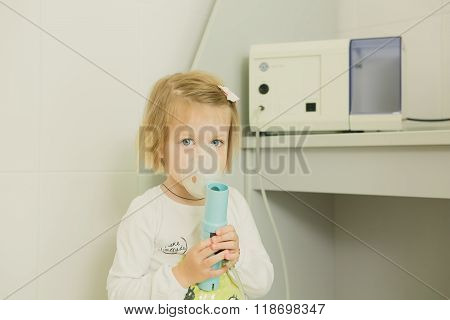 Girl with asthma inhaler.