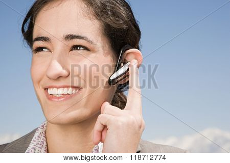 Woman with hands free device