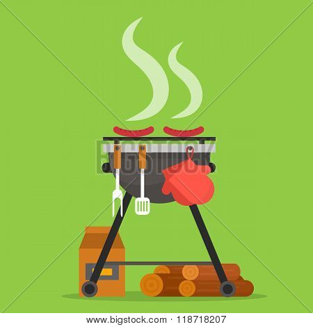 Barbecue. Grill with tools and firewood.