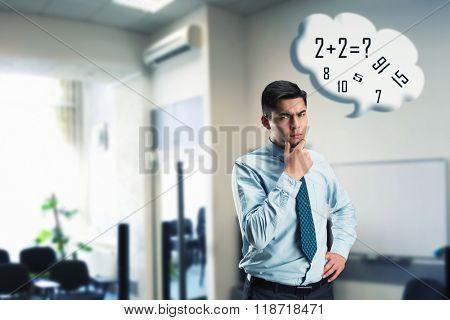 Businessman doing mental arithmetic