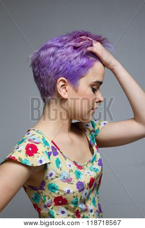 Profile Of A Short-haired Woman Holding Her Violet Hair