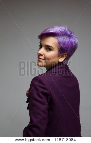 Back Of A Woman With Violet-short-hair Wearing A Violet Coat.