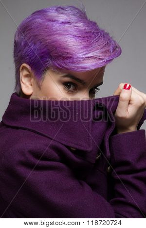 Violet Short-haired Girl Peeking Behind A Violet Coat.