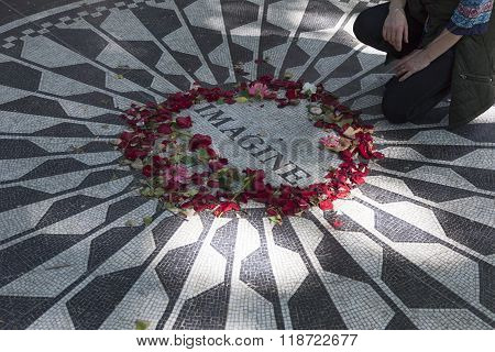 Man Pays Tribute To John Lennon On Mosaic Memorial In Central Park New York City