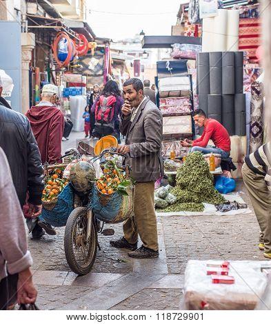 Peddler Selling Tangerine In A Street Of Rabat Medina. Morocco.