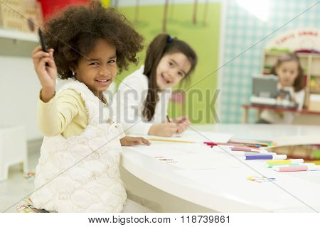 Children drawing in the playroom of the kindergarten