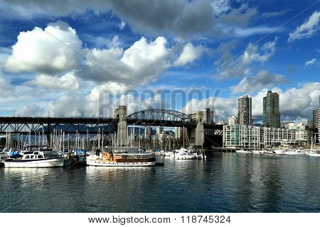 Burrard bridge and yachts in Vancouver by a nice sunny day