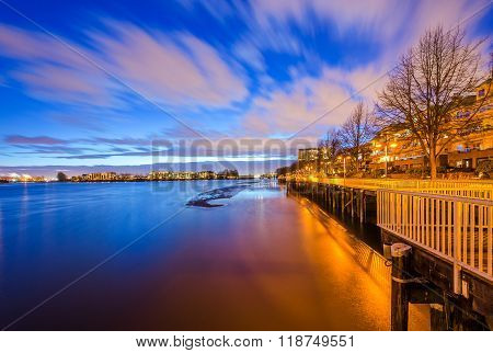 Quayside boardwalk in the evening. Fraser river, New Westminster, BC, Canada.