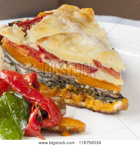 Vegetarian lasagne on white plate.