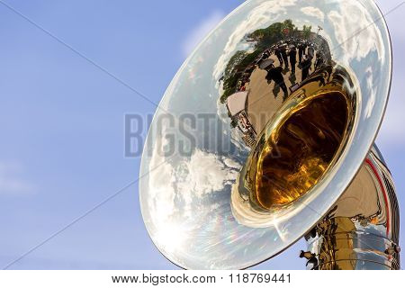 Big Brass Tuba With Reflections Against Blue Sky
