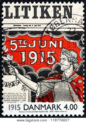 DENMARK - CIRCA 2000: a stamp printed in Denmark shows Allegory of Women Suffrage on Front Page of Newspaper 1915 circa 2000