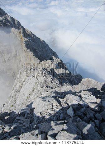 Mountain Watzmann via ferrata climbing route above the clouds