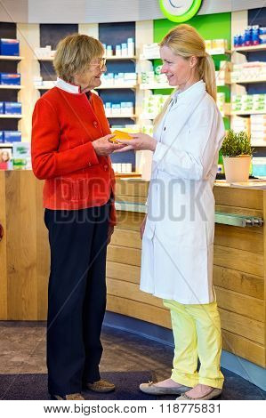 Pharmacist Giving Customer Medication Order