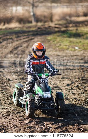 Boy Rides On Electric Atv Quad.