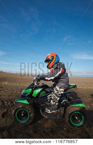 Boy Rides On Electric Atv Quad.