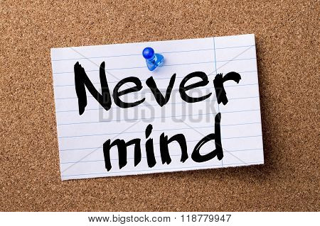 Never Mind - Teared Note Paper Pinned On Bulletin Board
