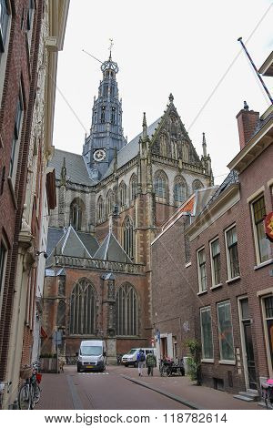 People Near The Grote Kerk (sint-bavokerk) In The Historic Centre Of Haarlem, The Netherlands.
