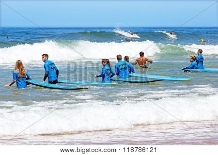 VALE FIGUEIRAS, PORTUGAL - August 20 2014: Surfers getting surfers lessons on the famous surfers beach Vale Figueiras in Portugal