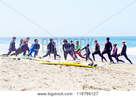 VALE FIGUEIRAS, PORTUGAL - August 20 2014: Surfers doing excersises on the famous surfers beach Vale Figueiras in Portugal