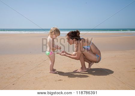 Collecting Sea Shells At Beach