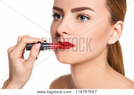 Beautiful female lips with make-up and pomade