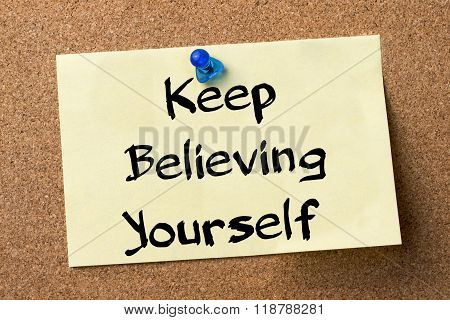 Keep Believing Yourself Key - Adhesive Label Pinned On Bulletin Board