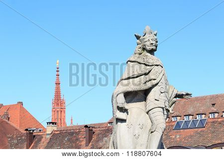 Statue of Pippin the Younger and Steeple of Marienkapelle in Wurzburg Germany