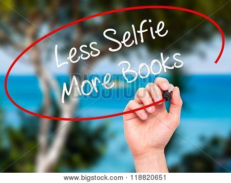 Man Hand Writing Less Selfie More Books With Black Marker On Visual Screen