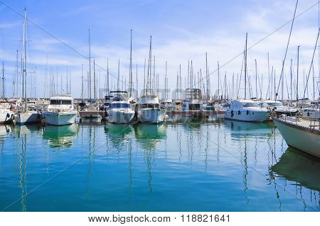 Stock Photo beauty Harbor Yacht Club with glazed clear sea and blue clouds