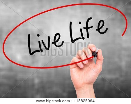 Man Hand Writing Live Life With Black Marker On Visual Screen