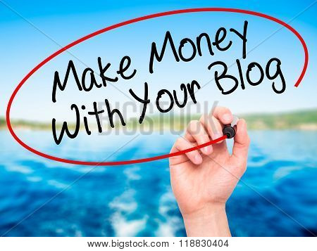 Man Hand Writing Make Money With Your Blog  With Black Marker On Visual Screen