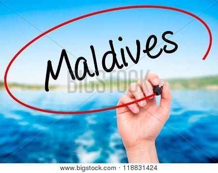 Man Hand Writing Maldives  With Black Marker On Visual Screen