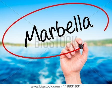 Man Hand Writing Marbella With Black Marker On Visual Screen