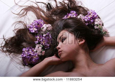Pretty young woman with flowers on her hair