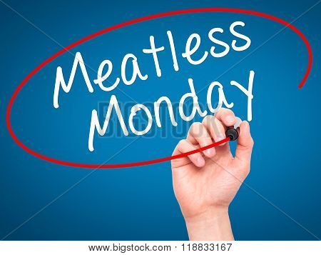 Man Hand Writing Meatless Monday With Black Marker On Visual Screen