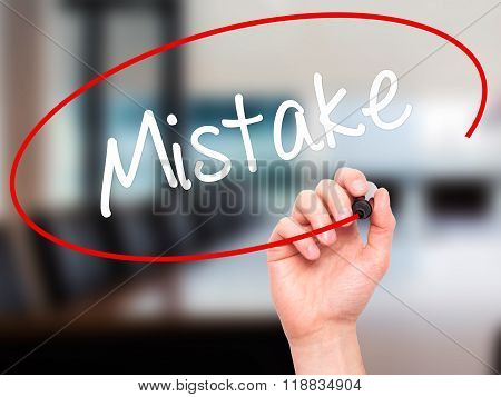 Man Hand Writing Mistake With Black Marker On Visual Screen