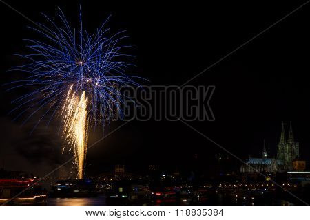 Blue firework in front of the cathedral of Cologne Germany