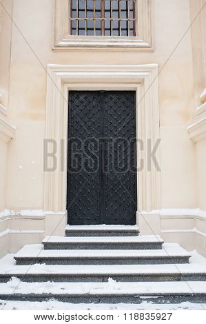 metal doors and stairs with snow in winter