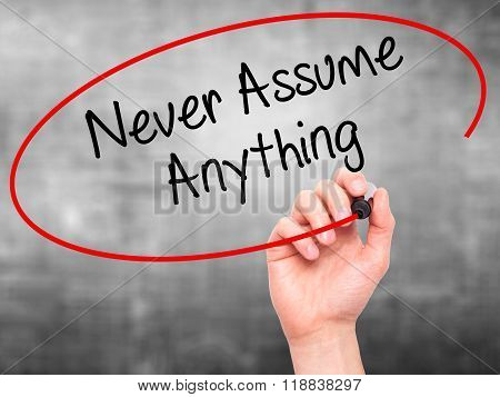Man Hand Writing Never Assume Anything With Black Marker On Visual Screen