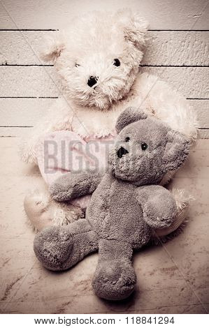 Teddy bears sitting on white wooden floor with nice background lonely