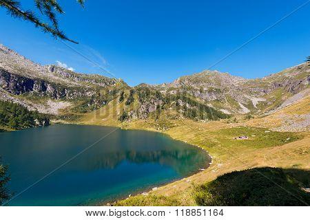 Lago di Campo (Campo lake) 1944 m. Small beautiful alpine lake in the National Park of Adamello Brenta Trentino Alto Adige Italy poster