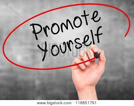 Man Hand Writing Promote Yourself With Black Marker On Visual Screen
