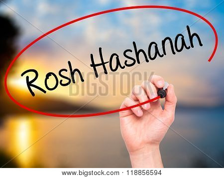 Man Hand Writing Rosh Hashanah With Black Marker On Visual Screen