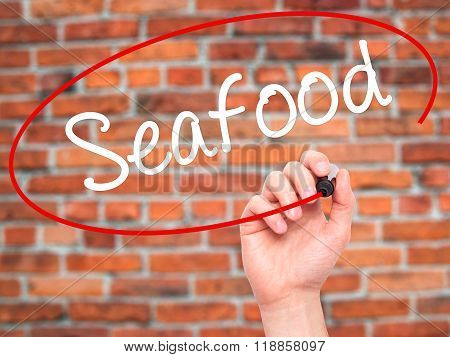 Man Hand Writing Seafood With Black Marker On Visual Screen
