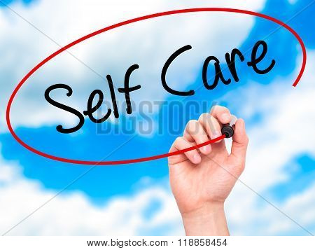 Man Hand Writing Self Care With Black Marker On Visual Screen