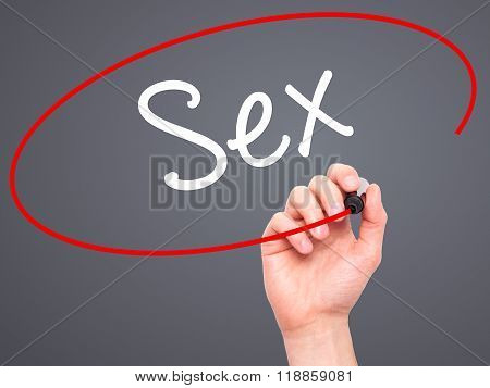 Man Hand Writing Sex With Black Marker On Visual Screen