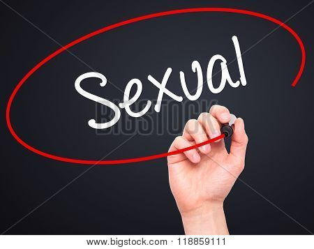 Man Hand Writing Sexual With Black Marker On Visual Screen
