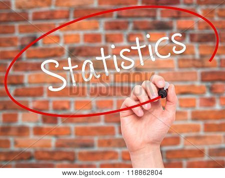Man Hand Writing Statistics With Black Marker On Visual Screen