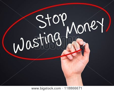 Man Hand Writing Stop Wasting Money With Black Marker On Visual Screen