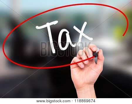 Man Hand Writing Tax With Black Marker On Visual Screen